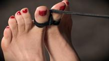 Lorelei Lee bent over pole in metal bondage