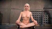 Lorelei Lee in belt bondage, having feet caned