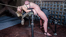 Dee Williams down on all fours for a caning