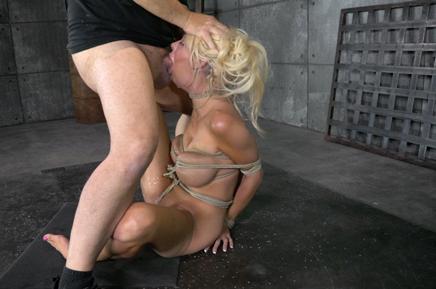 Bound blonde bimbo Courtney Taylor deepthroats hard cock