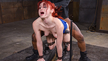 Pale redhead Violet Monroe deepthroats BBC in bondage