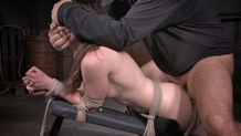Bound Amy Faye suffers in tight rope bondage