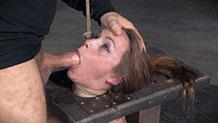 Bound Bella Rossi deepthroating hard cock
