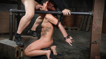 Shackled slut Savannah Fox deepthroating on a sybian