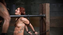 Pretty redhead Savannah Fox smiles at the BBC while chained