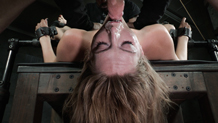 Pretty pale Mona Wales shackled down in metal bondage