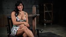 Restrained Asian Mia Li deepthroats in bondage