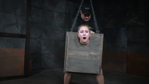 Small blonde Odette Delacroix suspended in a box