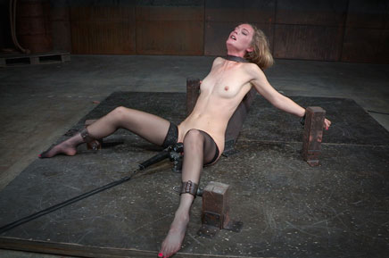Pale thin Mona Wales bound down in shackles