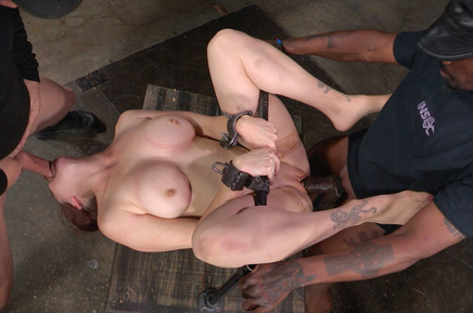 Shackled slave Bella Rossi stuffed from both ends by dick