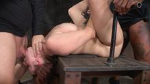 Grinning Bella Rossi in bondage