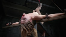 Bound Mona Wales belted down in an inversion