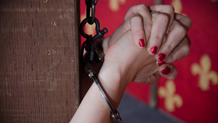 Mandy Muse in handcuffs