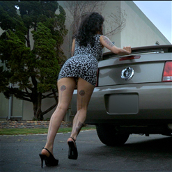 Arabelle Raphael in short skirt and heels pushes her car