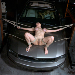 Arabelle Raphael ankles tied rope bondage on car hood