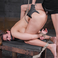 Penny Barber in bondage with leather hood on Topgrl