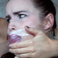 Bella Rossi looking confused in tape and cloth gag