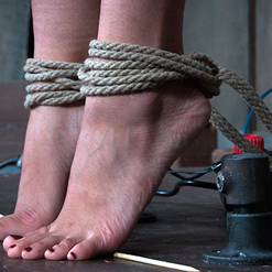 Milcah Halili cries out in neck rope bondage